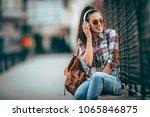 beautiful female student... | Shutterstock . vector #1065846875
