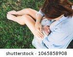 baby eating mother's milk on... | Shutterstock . vector #1065858908