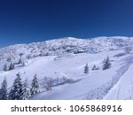 ski run and skiers at winter... | Shutterstock . vector #1065868916