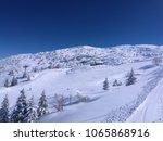 ski run and skiers at winter... | Shutterstock . vector #1065868916
