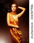 woman in long yellow dress | Shutterstock . vector #106587986