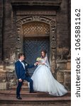 bride and groom stand on steps... | Shutterstock . vector #1065881162
