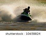 Backlit jet ski with water spray - stock photo