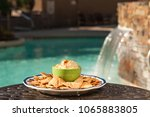 plate of pita chips and bowl of ... | Shutterstock . vector #1065883805