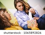 the sad woman being comforted... | Shutterstock . vector #1065892826