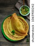 Small photo of Pesarattu Dosa - Indian breakfast crepes with green gram served with cilantro chutney top view