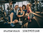 friends having fun at the gym.... | Shutterstock . vector #1065905168