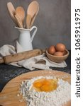 eggs  dough  flour and rolling... | Shutterstock . vector #1065911975