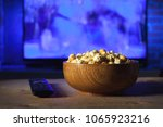 a wooden bowl of popcorn and... | Shutterstock . vector #1065923216