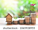 house model on saving coin... | Shutterstock . vector #1065928955