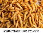closeup of french fries... | Shutterstock . vector #1065947045