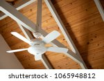 white ceiling fan on an exposed ...