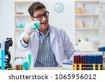 Young chemist student working...