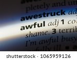 Small photo of awful word in a dictionary. awful concept.