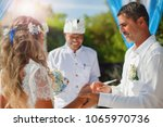 wedding couple just married at... | Shutterstock . vector #1065970736