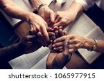 group of people holding hands... | Shutterstock . vector #1065977915