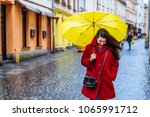 smiling woman in red coat with... | Shutterstock . vector #1065991712