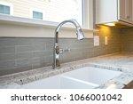 Stock photo kitchen sink with backsplash 1066001042