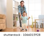 first steps of baby toddler... | Shutterstock . vector #1066015928
