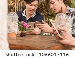 group of teenager adding friend ... | Shutterstock . vector #1066017116