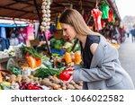young long hair girl buying... | Shutterstock . vector #1066022582