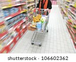 woman is moving shopping cart ... | Shutterstock . vector #106602362
