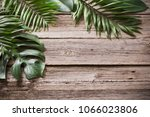 exotic leaves on old wooden... | Shutterstock . vector #1066023806