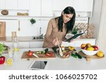 woman cooking vegetable summer... | Shutterstock . vector #1066025702