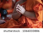 Small photo of The young novice monks pray in summer at Buddhist temple in Thailand, southeast Asia.