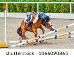 young rider falling from horse... | Shutterstock . vector #1066090865