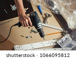 man's hand with tools for... | Shutterstock . vector #1066095812