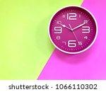 closeup pink wall clock set on... | Shutterstock . vector #1066110302