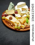 cheese plate with assorted... | Shutterstock . vector #1066115405