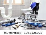 plumber tools and equipment in... | Shutterstock . vector #1066126028