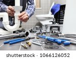 plumber at work in a bathroom ... | Shutterstock . vector #1066126052
