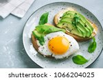 avocado sandwich with fried egg ... | Shutterstock . vector #1066204025