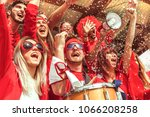 group of fans dressed in red... | Shutterstock . vector #1066208258
