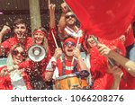 group of fans dressed in red... | Shutterstock . vector #1066208276