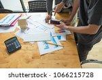 business adviser analyzing... | Shutterstock . vector #1066215728