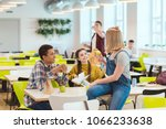 Stock photo happy high school students taking lunch together at school cafeteria 1066233638