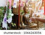 sprinkle water onto a buddha... | Shutterstock . vector #1066263056