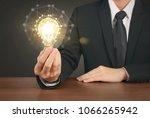 holding lightbulb in a hand   Shutterstock . vector #1066265942