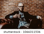 young brutal businessman is... | Shutterstock . vector #1066311536