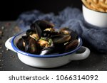 moules frites  mussels and... | Shutterstock . vector #1066314092