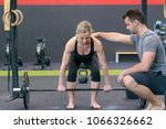 personal trainer helping woman... | Shutterstock . vector #1066326662