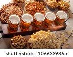 lager beer and snacks on wooden ... | Shutterstock . vector #1066339865