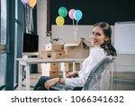 happy businesswoman sitting on...   Shutterstock . vector #1066341632