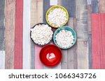 pumpkin seeds in colored bowls... | Shutterstock . vector #1066343726