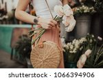 blogger girl holding a bunch of ... | Shutterstock . vector #1066394906