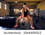 muscular fit woman doing... | Shutterstock . vector #1066400312